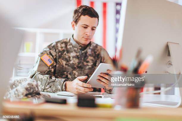 soldier in the office - army soldier stock photos and pictures