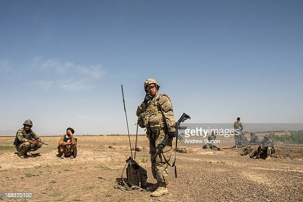 A soldier in the US Army's 1st Battalion 36th Infantry Regiment Bravo Company speaks on the radio after a United States vehicle hit an improvised...