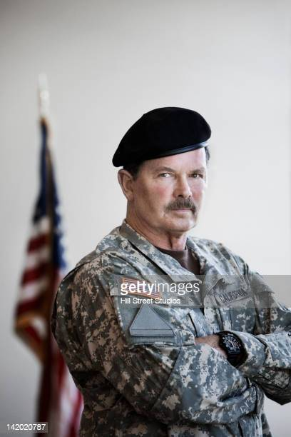 Soldier in uniform standing with arms crossed