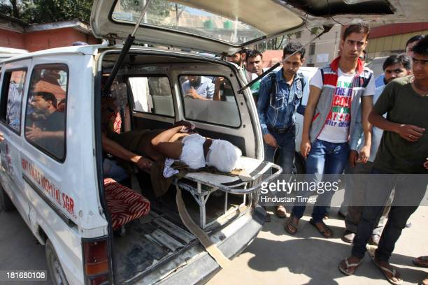 CISF soldier injuredin militant attack lying on a stretcher inside an ambulance on September 23 2013 in Srinagar India Reportedly a Central...