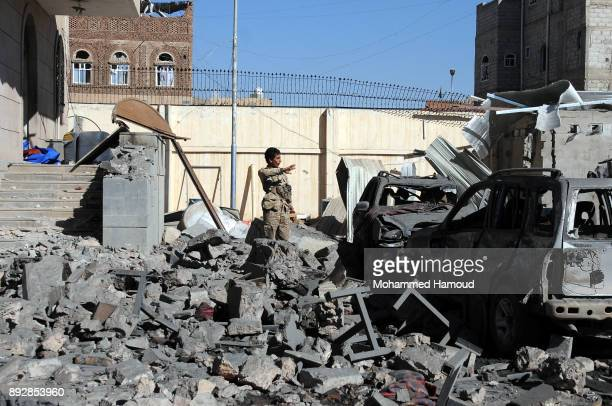 A soldier inspects the prison after it was hit by airstrikes on December 13 2017 in Sana'a Yemen More than 12 prisoners killed and 80 others injured...