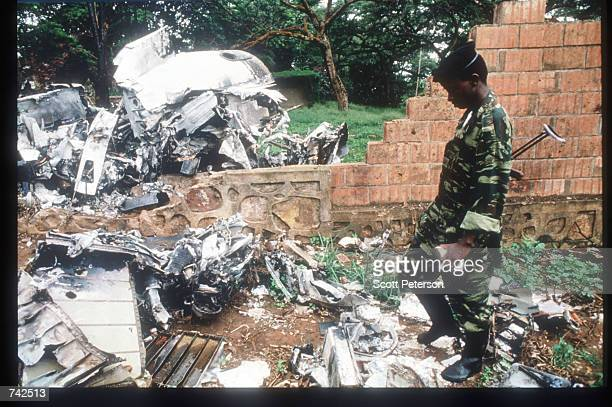 Soldier inspects the wreckage of the plane crash that killed the Rwandan President May 25, 1994 in Rwanda. Following the assassination of President...