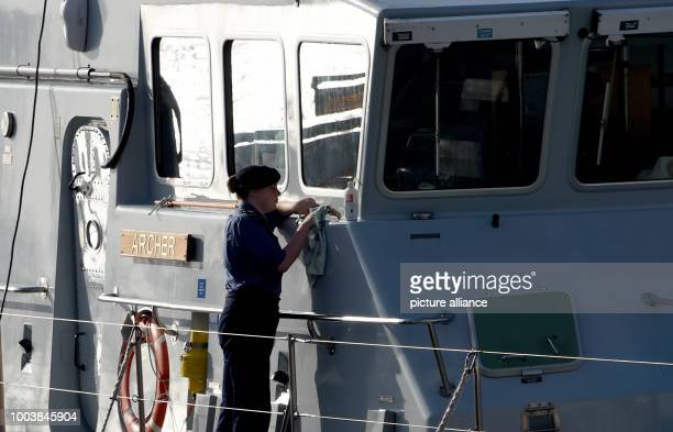 A soldier is cleans the English battle ship 'Archer' in Kiel Germany 16 June 2017 More than 40 navy ships from 13 nations will lie at anchor here...