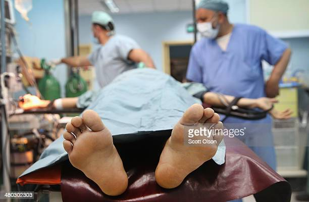A soldier is prepped for surgery in the Paktia Regional Military Hospital at Forward Operating Base Thunder on March 24 2014 near Gardez Afghanistan...