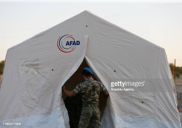 A soldier is seen in front of a tent which has been set up for people whose house were damaged on earthquake at Bozkurt Stadium by Turkeys Disaster...