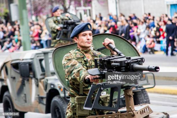 A soldier is seen on an armored vehicle holding a machine gun during the parade A military parade takes place due to Independence Day in Greece 25th...