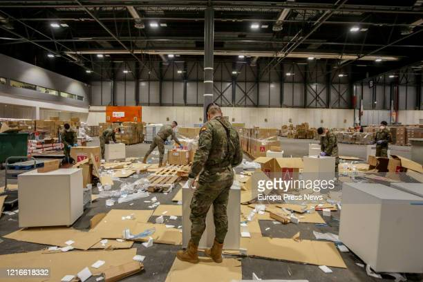 A soldier is seen preparing the material at pavilion 10 at the campaign hospital of IFEMA poreparing the material established to help during the...