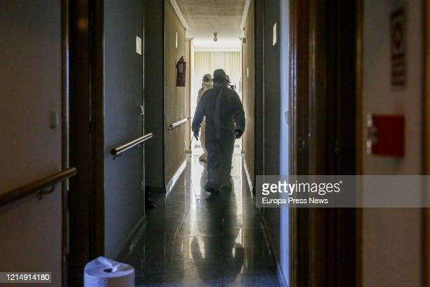 Soldier is seen while disinfecting the nursing home San Carlos del Bosque at the town of Villaviciosa de Odon, one of the hundreds of nursing homes...