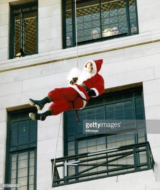 Soldier John Greenfield dressed as Father Christmas was abseiling down the side of a store when his nylon beard got caught round the rope Luckily a...
