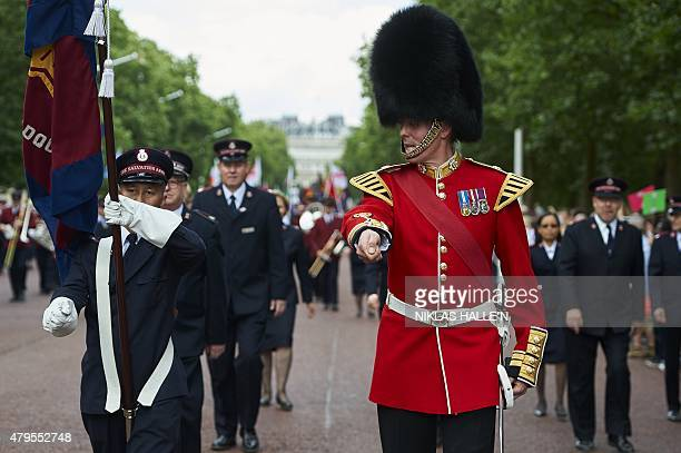 A soldier joins marchers in a march to celebrate the 150th anniversary of the Salvation Army on July 5 2015 in central London The Salvation Army has...