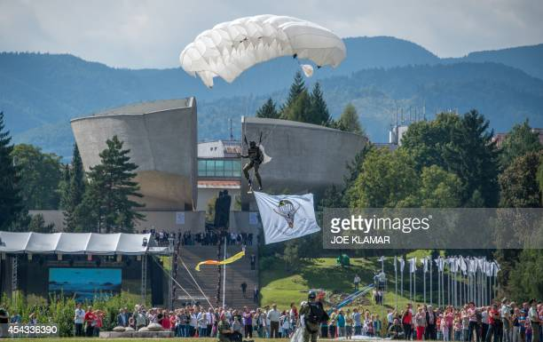 A soldier jumps with parachute during the ceremonies to commemorate 70 years anniversary of the Slovakia's National Uprising at the Museum of SNP in...