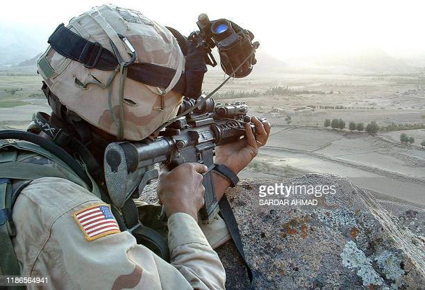 A US soldier keeps a close look out for suspected Taliban fighters in violencewracked Zabul province some 300 kms southwest of the Afghan capital...