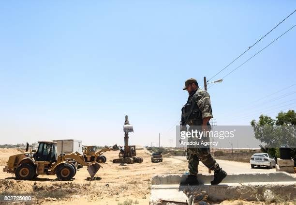 Soldier keeps guard as the establishment of the 100 meters wide buffer zone along the Egyptian border continues to heighten control measure in Gaza...
