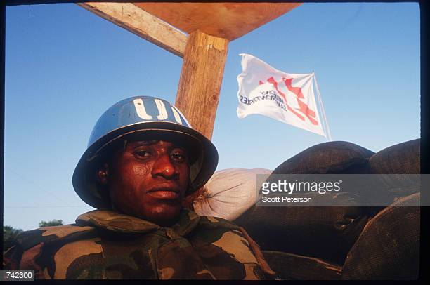 UN soldier keeps watch at a checkpoint January 23 1994 in Mogadishu Somalia The UN peacekeeping mission aimed at ensuring food delivery in the east...