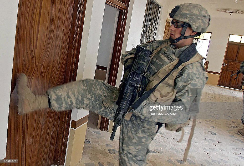 A US soldier kicks a door as he conducts a search in a building in the & A US soldier kicks a door as he conducts Pictures   Getty Images pezcame.com