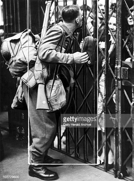 Soldier kissing his wife through railings Second World War 15 May 1940 'Troops going back to France after leave Scene on a London station when one of...
