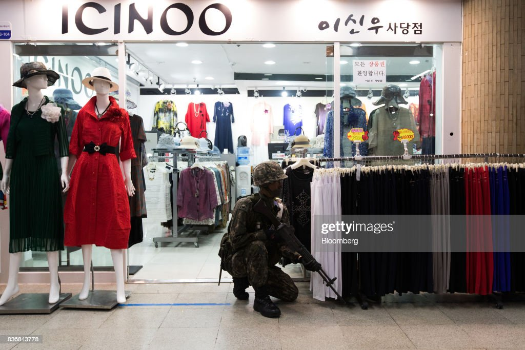 A soldier kneels in front of a clothing store during an anti-terror drill on the sidelines of the Ulchi Freedom Guardian (UFG) military exercises at a subway station in Seoul, South Korea, on Tuesday, Aug. 22, 2017. North Korea warned the U.S. on Tuesday it will face 'merciless revenge' for ignoring Pyongyangs warnings over annual military drills with South Korea. Photographer: SeongJoon Cho/Bloomberg via Getty Images