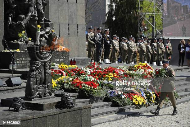 A soldier lays a wreath during the main commemoration ceremony of the 75th anniversary of the Warsaw Ghetto Uprising at the Ghetto Heroes Monument on...