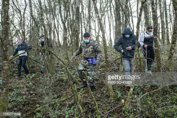 Soldier leads a group of people during a search organised by French gendarmes in the woods of Milhars, on December 23 to look for Delphine Jubillar,...