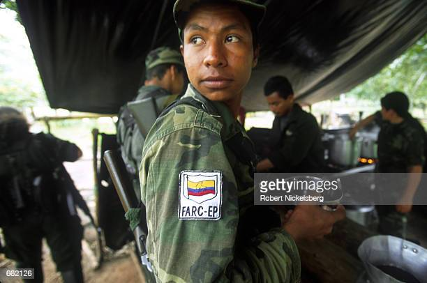 Soldier lines up for food at a mess kitchen August 25, 2000 at FARC headquarters in Los Pozos, Colombia. The FARC maintains a force of 15,000...