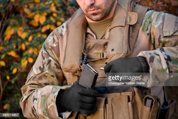 soldier loading automatic weapon during training - ammunition magazine stock photos and pictures