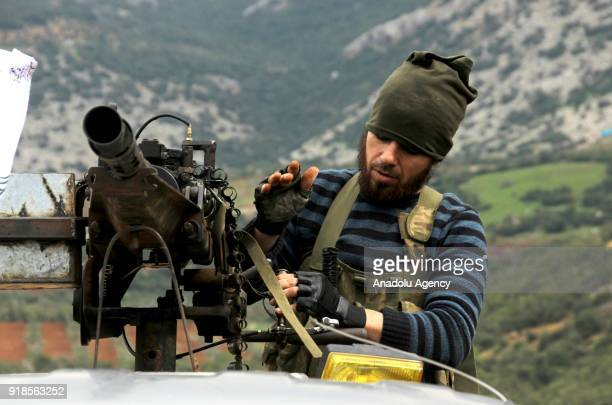 A soldier loads a gun while Turkish military and Free Syrian Army search the Shadia village after liberating the villages of Karri Sharbanli along...