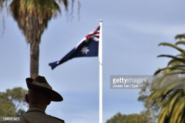 soldier looking at australian flag - australian culture stock pictures, royalty-free photos & images
