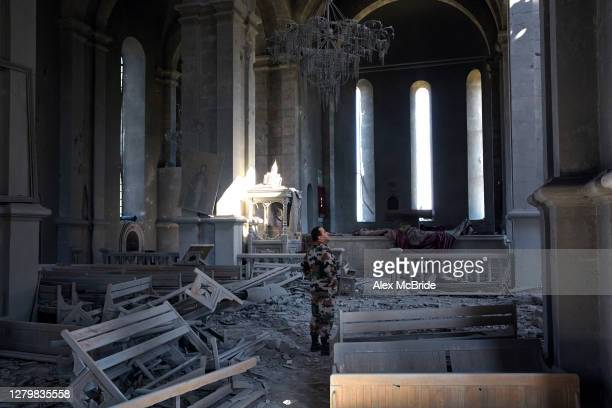 Soldier looks at the damage done to a church which was struck twice by UAV strike on October 12, 2020 in Shoushi, Nagorno-Karabakh. On the day after...