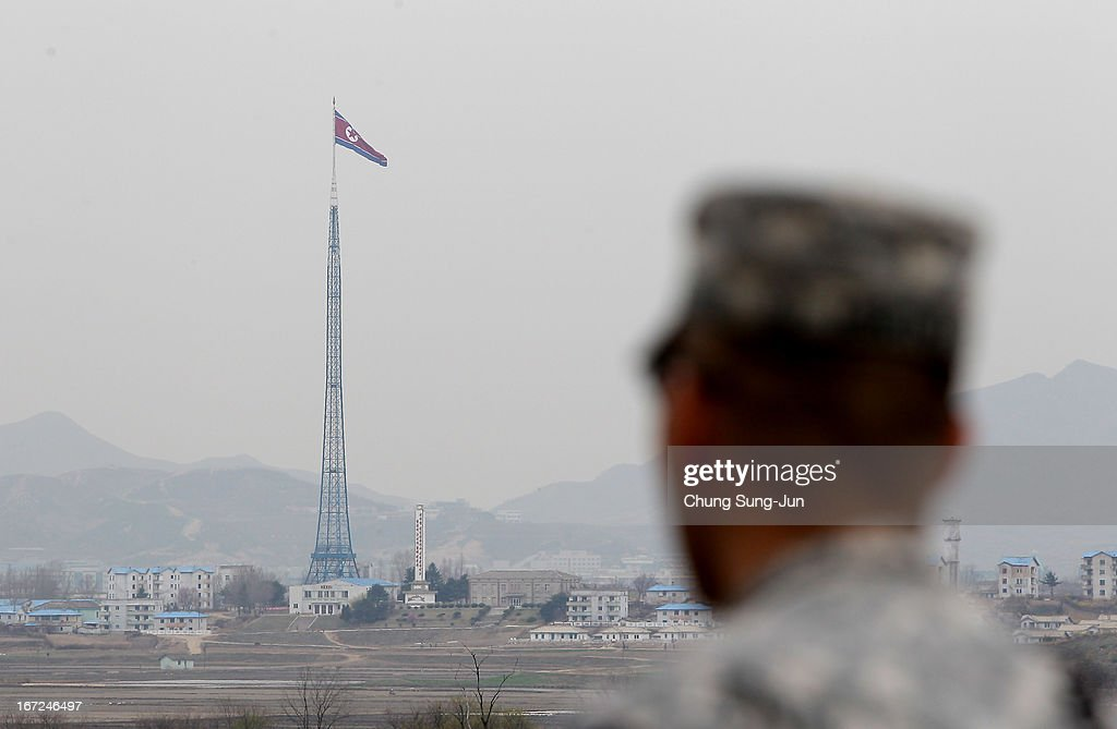 S. soldier looks towards North Korea as he stands guard at the border village of Panmunjom between South and North Korea on April 23, 2013 in Panmunjom, South Korea. The tension at Korean Peninsula remains high as North Korea's ballistic missiles have been ready to launch ahead of North Korean Army foundation celebration day on April 25.
