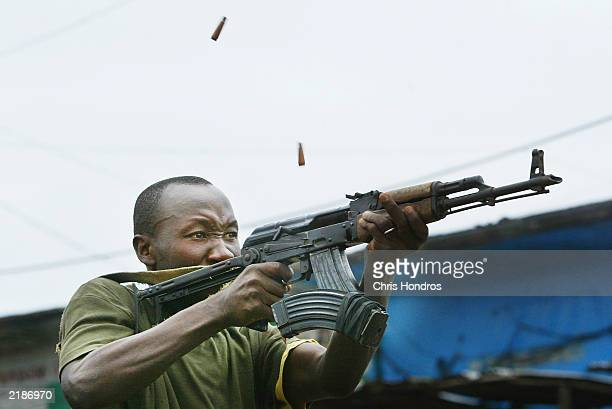 A soldier loyal to the government fires off a volley of automatic weapons fire July 23 2003 in Monrovia Liberia Clashes continuted in the Liberian...