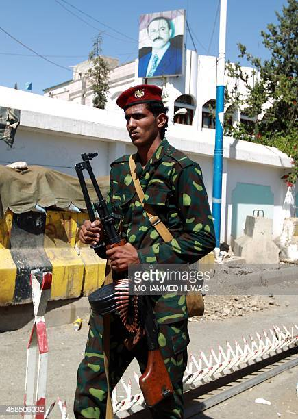 A soldier loyal to Yemen's former president Ali Abdullah Saleh stands guard outside the former headquarters of his party the General People's...