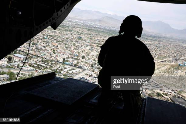 S soldier mans a gun at the back gate aboard the helicopter carrying US Defense Secretary James Mattis as he arrives via helicopter at Resolute...