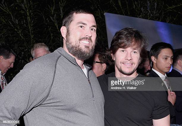 S Soldier Marcus Luttrell and actor/producer Mark Wahlberg attends The Giving Back Fund's Big Game Big Give at the home of Erika and Matt Williams on...
