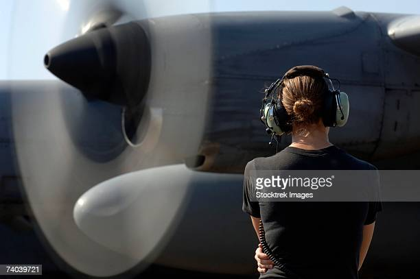 a soldier monitors the performance of a newly repaired c-130 hercules engine that had a new valve housing installed december 13 at camp lemonier, djibouti. - military airplane stock pictures, royalty-free photos & images