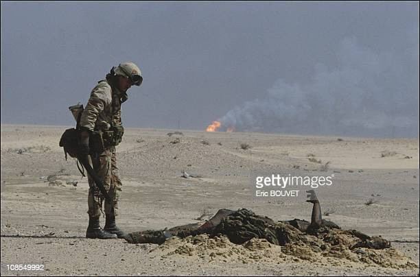 US soldier near the dead body of an Iraqi soldier on February 27th 1991