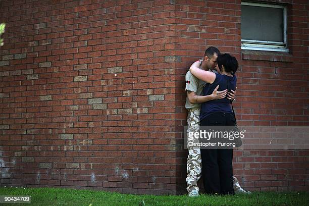 Soldier of 2nd Battalion The Yorkshire Regiment kisses his partner as he and comrades leave their barracks in Lancashire to deploy to Afghanistan on...
