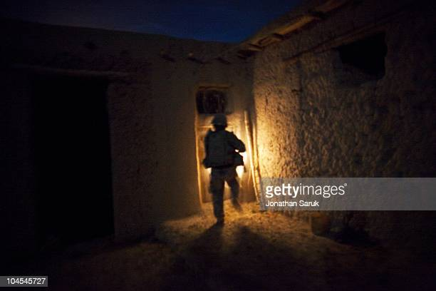US soldier of 3rd Platoon Delta Company of the 3rd Brigade 10th Mountain Division searches a compound after an ambush May 8 2009 in the Onkai Valley...