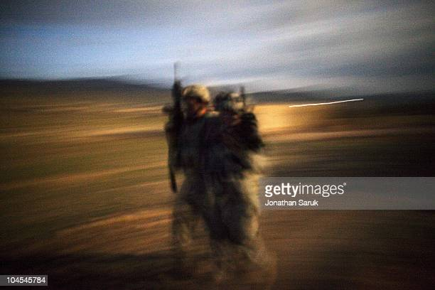 US soldier of 3rd Platoon Delta Company of the 3rd Brigade 10th Mountain Division helps an injured comrade at night after an ambush May 8 2009 in the...