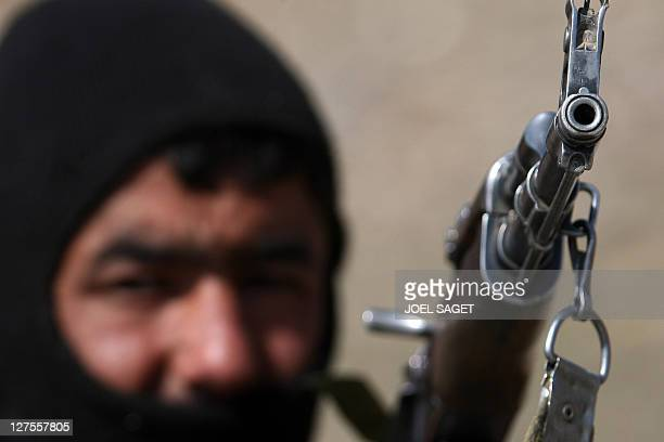 Soldier of ANA with his Kalashnokov, is pictured during the CIMIC operation on February 16, 2009 in Dawlatkhel, in the Alassay valley. AFP PHOTO JOEL...