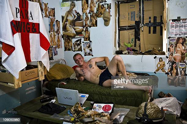 A soldier of Dcompany 2nd Battalion of Britain's Parachute Regiment relaxing at Forward Operating Base Zeebrugge 8 May 2008 Northern Helmand Province...