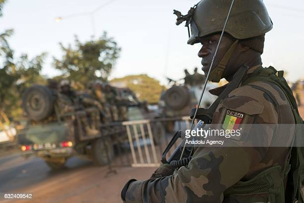 A soldier of ECOWAS troops patrols in a street after the former President Yahya Jammeh fled the country in Banjul Gambia on January 22 2017 Yahya...