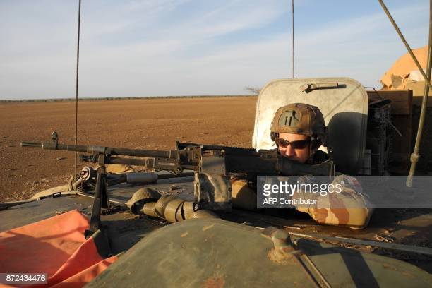 A soldier of France's Barkhane patrols in a military vehicle on November 2 2017 in central Mali in the border zone with Burkina Faso and Niger as a...