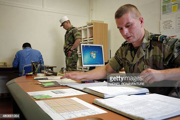 MOUTOT A soldier of French Foreign Legion works in his office at the recruitment center in Fontenaysousbois outside Paris on June 22 2015 Thousands...