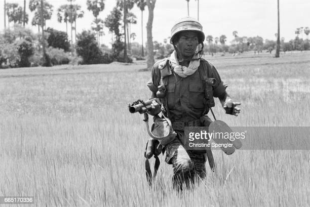 Soldier of government forces on the front line near Phnom Penh Since the Lon Nol coup in March 1970 two groups fought for control of Cambodia the...
