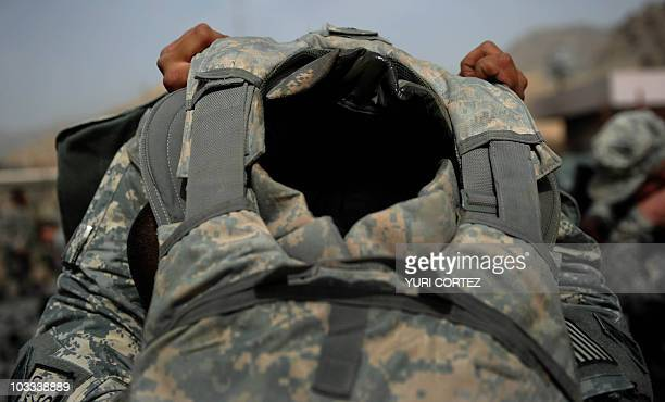 US soldier of HHC TF 166 1BTC 4ID takes off his bulletproof vest after arriving at a US base in Arghandab Valley located in Kandahar province on...