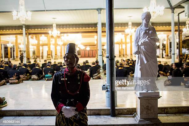A soldier of Kasunanan Surakarta stands guard while awaiting the traditional night carnival '1st Suro' marking the 1437th Islamic New Year...