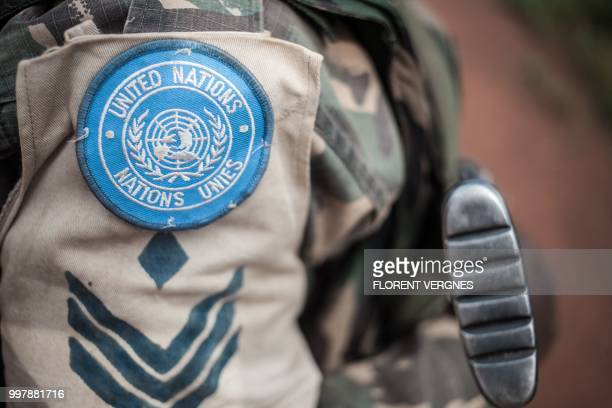 A soldier of Tanzanian contingent from the UN peacekeeping mission in the Central African Republic patrols the town of Gamboula threatened by the...