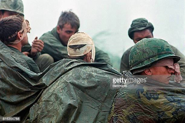 Soldier of the 1st Cavalry Division many with head wounds wait to be evacuated from a hilltop along route during their advance toward Khe Sanh |...