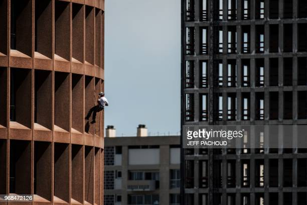 Soldier of the 7th regiment of Materiel climbs the Lyon Part-Dieu tower on June 6, 2018 to celebrate regiment's 130th anniversary.
