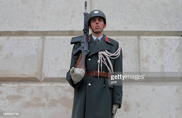 A soldier of the Austrian army stands guard during a ceremony to mark the 75th anniversary of the Anschluss of Austria to the Third Reich in 1938 in...